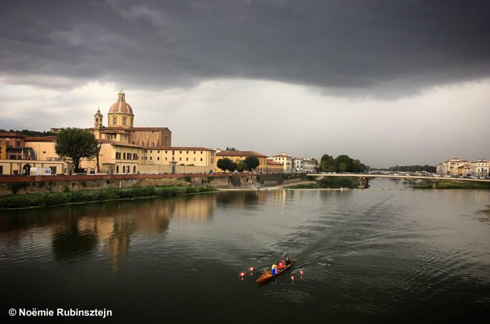 This photo was taken in Florence while walking around and next the Arno river. I came across these brave kayaking people who were obviously going to face a humongous storm.