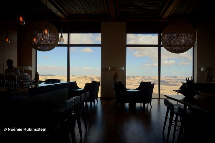 This photo was taken in a hotel in Mitzpe Ramon, Israel, which was built in a way that it is completely overlooking the Ramon crater, leading to a magical experience. The hotel was build in a way to suit the crater and lead to a Swiss chalet designed hotel.