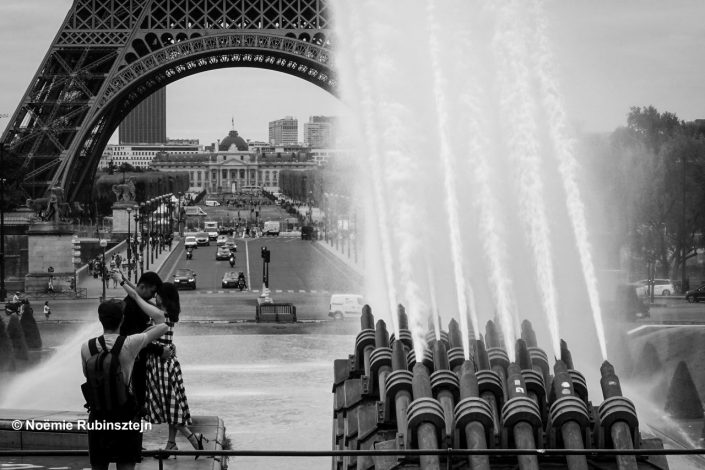 The photo was taken in Paris on assignment on the Eiffel Tower. I walked to the Trocadéro where I shot this picture of a couple and their personal photographer.