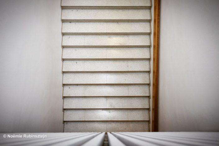 This photo was taken in Jerusalem at the Israel Museum and features one of its staircases. The latter was shot in a way that it looks as if the staircase is standing.