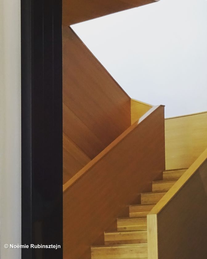 This photo was taken in Jerusalem in a hotel and features its wooden staircase which looks like a drawing.