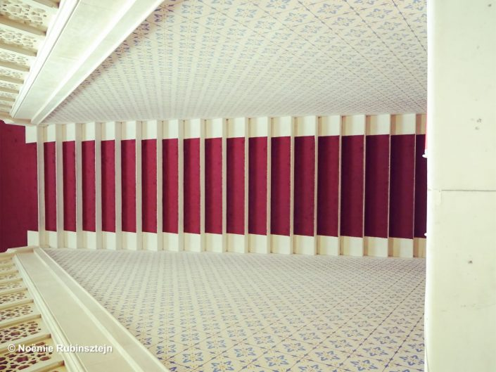 This photo was taken in Sarajevo and features the beautiful white staircase with its red carpet at the City Hall.