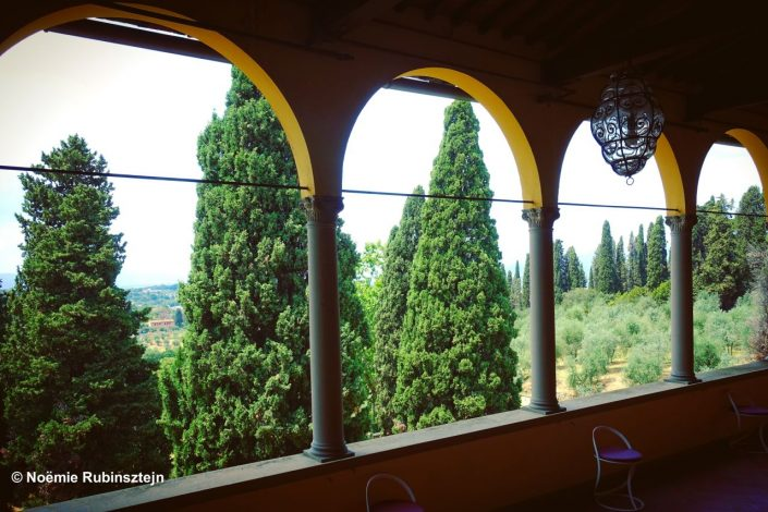 This photo was taken in Florence in a big house with a view on a garden which is filled with loads of passageways and stairs which keep on meeting and disappearing.