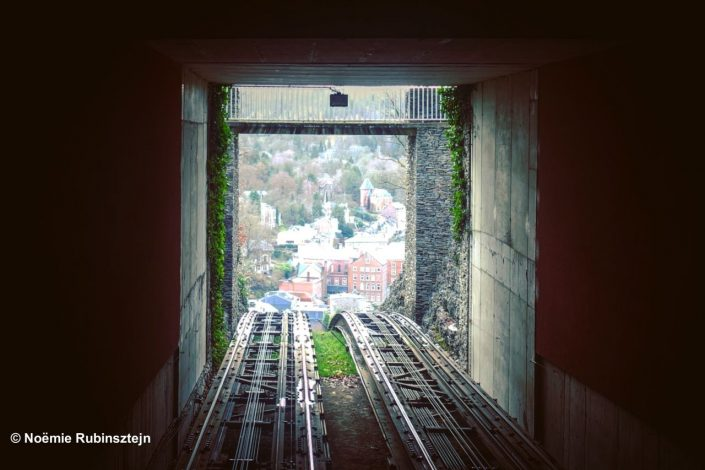 This photo was taken in Spa and features the view of the city from a funicular.